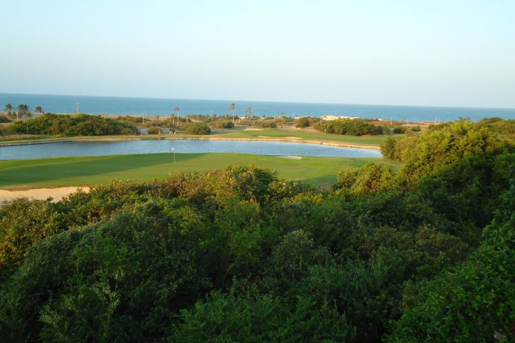 View on the perfect green of the course of the Aquiraz Riviera & Dunes golf club.
