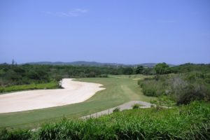 Bunker and fairway of the course of the Buzios golf club.